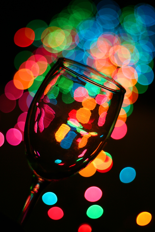 Wine glass and holiday lights